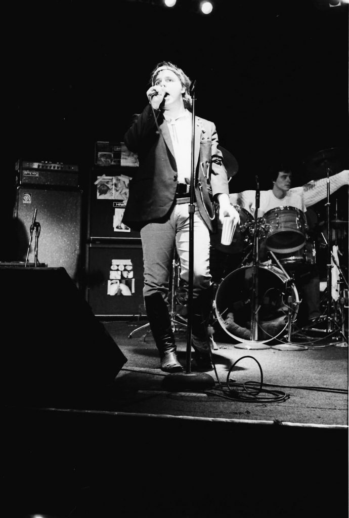 Jeffrey Lee pierce singing on stage